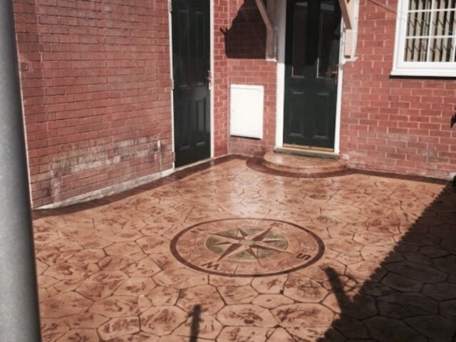 Sandstone walnut colour with acid edge printed concrete driveway