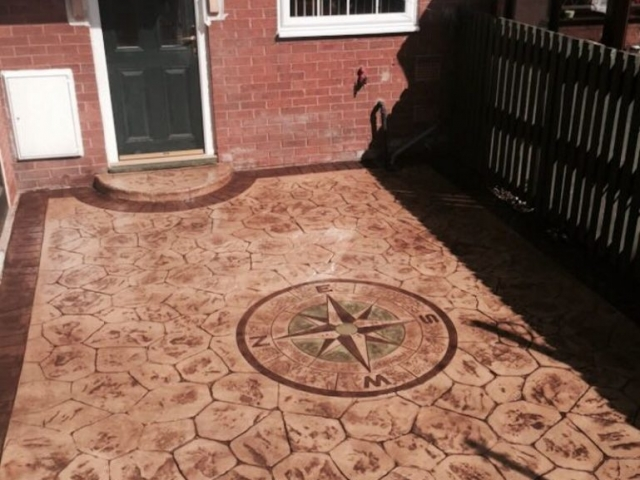 Sandstone walnut colour with acid edge printed concrete driveway