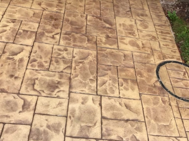 Sandstone and Mahogany Release printed in Ashlar concrete driveway