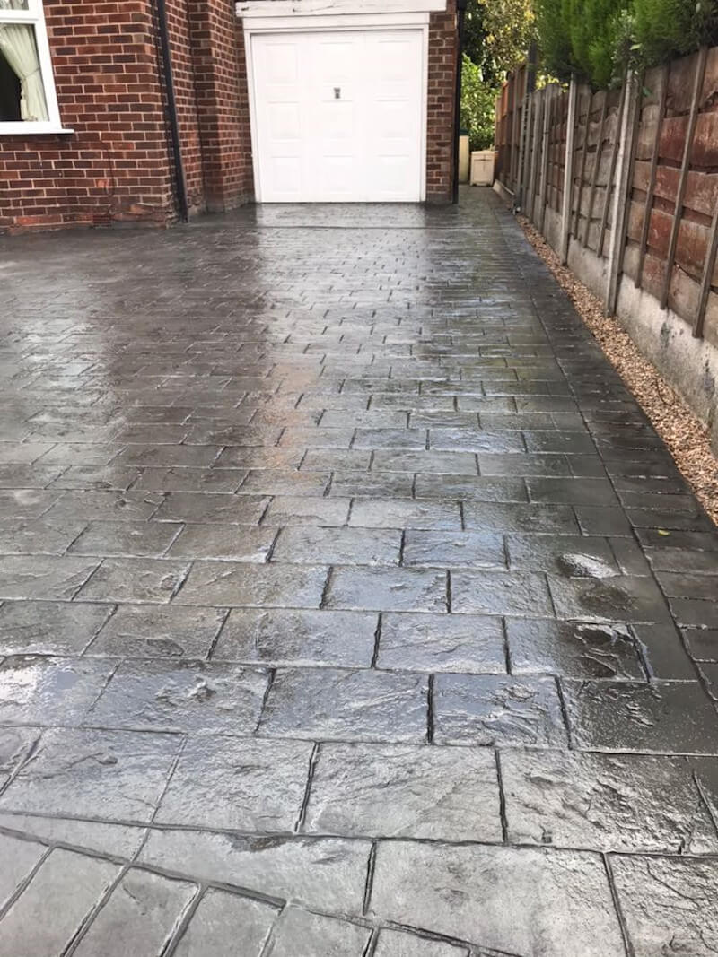 New concrete driveway in Basalt Grey and printed in large London Cobble
