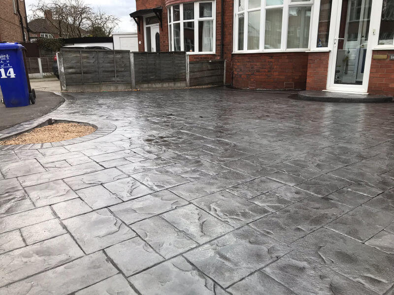 New concrete driveway in platinum grey colour