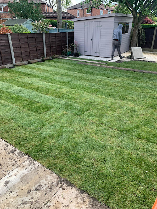 New garden turf and flags